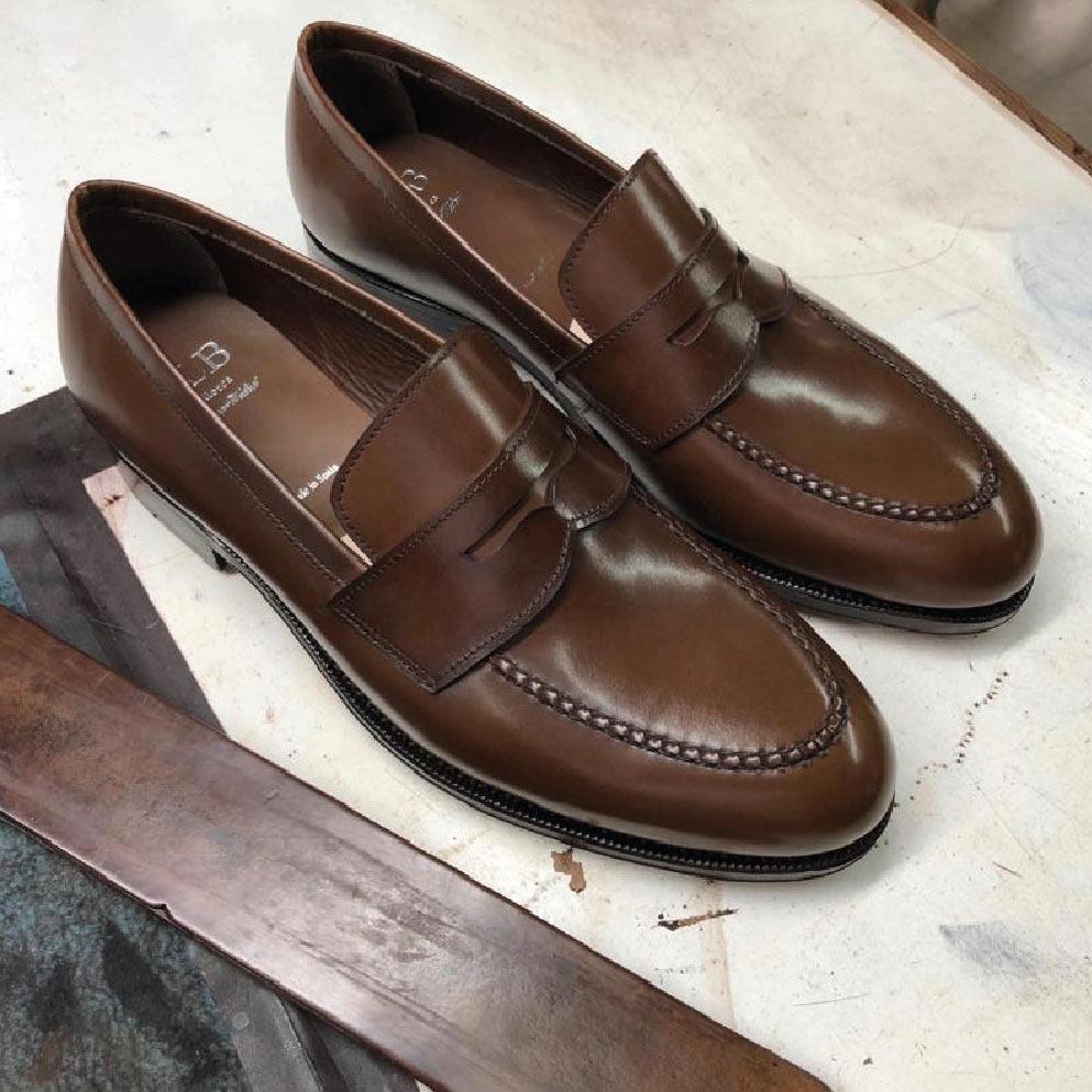Brązowe mokasyny typu penny loafer